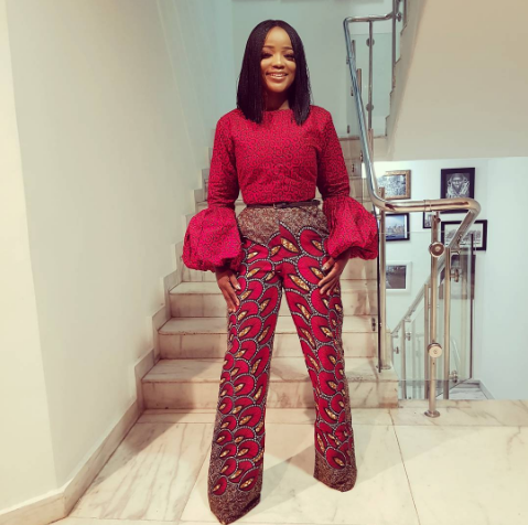 8227ce95a39 Nini stepped out looking flawless in this puff sleeve mixed print ankara  jumpsuit.