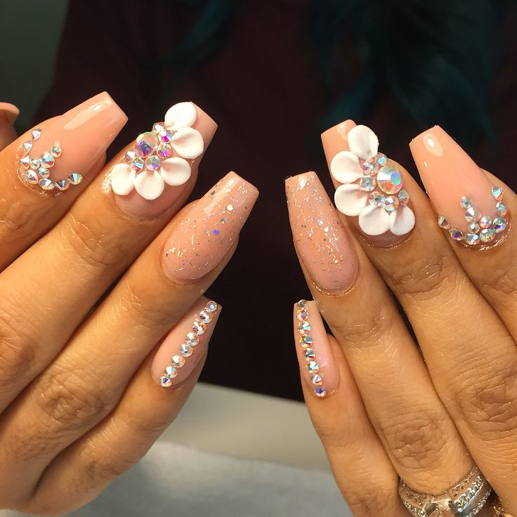 1. A lovely piece featuring stones and acrylic petals - 3D Nail Art Designs To Inspire Your Next Manicure FabWoman