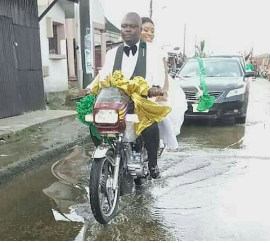 Nigerian Couple Make Headlines As They Ride Home On A Bike After Their Wedding