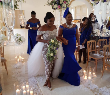 father walking the bride down the aisle tradition: nigerian author shares thoughts on the need to change status quo Father Walking The Bride Down the Aisle Tradition: Nigerian Author Shares Thoughts On The Need To Change Status Quo woman walks with mother down the aisle